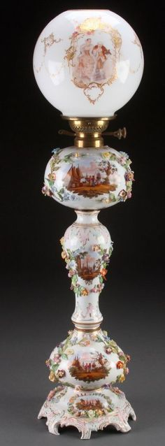 Dresden Hand Painted Scenic Porcelain Banquet Lamp With Applied Flowers Mounted On A Similarly Decorated Three-Section Base, Duplex Burner With Hand Painted Scenic And Gold Encrusted Opal Shade, Blue Crossed Swords Mark Under Glaze On Base   c. 1885