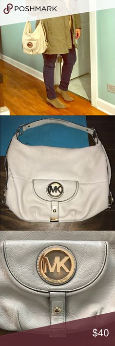 Michael Kors ivory cream leather shoulder hobo bag Beautiful handbag. Leather is absolutely beautiful. It has been previously worn and is not in the best condition but it still has lots of life left. The flaws include: scratches on the gold hardware, staining throughout interior and exterior as seen in pictures. The strap is in need of repairs, it has loose threads, and shows a lot of wear. Please see all the pictures carefully. This is a gorgeous bag, but remember Price reflects condition…