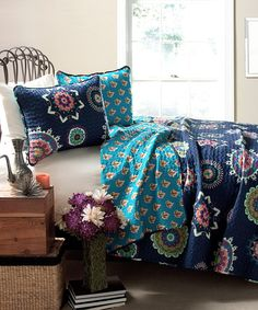 Just something from zulily, but I love this color combo. Super simple quilt. One side large, bold print, other side small print with bright coordinating color. Very striking.