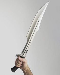 No automatic alt text available. Ninja Weapons, Weapons Guns, Swords And Daggers, Knives And Swords, Armas Ninja, Cool Swords, Sword Design, Concept Weapons, Cool Knives
