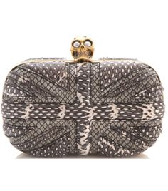 Snakeskin Britannia Clutch Bag by Alexander Mcqueen. Monochrome, snakeskin, union jack embossed moulded clutch. Gold metal frame. Gold metal skull clasp with Swarovski crystals and pearl eyes. #Matchesfashion