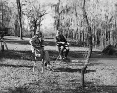 John Wayne and Director John Ford sit and talk while on location for The Horse Soldiers (1959).
