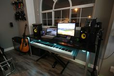 Lower the piano, raise the desk if necessary...