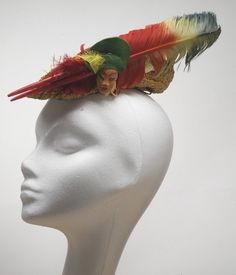 """1940s Bes-Ben """"Three faces"""" feathers hat   United States   Materials: straw, felt, feathers, clay faces   Via Indianapolis Museum of Art."""