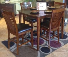 """Stuman Dining Table w/ 4 Side Chairs  With a warm medium brown finish flowing beautifully over the sleek contemporary design, the """"Stuman"""" dining collection features comfortably shaped comb back chairs with polyurethane padded seats to add a level of comfort and style to any dining experience. At #AshleyFurniture in Richland, WA #TriCities #Contemporary #Dining #TriCitiesWA #Yakima #WallaWalla #Wa"""