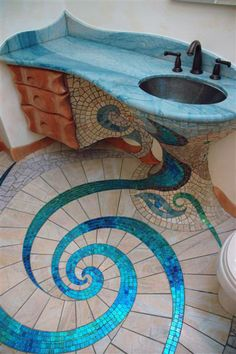 would be great in a guest bath of beach house mosaic tile bathroom floor and sink love