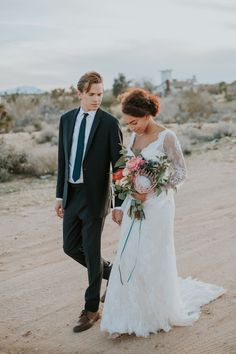 Sneak Peak of our Desert Elegance Styled Shoot at Joshua Tree by the  Talented Creative Vendors: Location: @serenityescapejt Planner & Design: @theblushingdetails  Hair and Make-up: @beautybybonbon Florist Designer:  @venicewildflower Tux: @theblacktux Wedding Dress: @bylillianwest