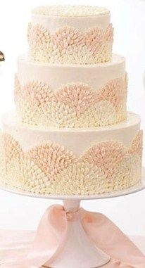 If they made the peach color turquoise I would love this cake.