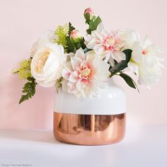 Create an appealing entrance into your home living area with decorative containers, like this Monte Carlo ceramic flower pot in a white and copper color block pattern. This trendy vase is perfect for