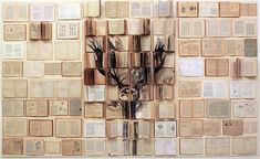 Russian artist Ekaterina Panikanova places old books and other documents together and paints over them to create the most beautiful installations.8