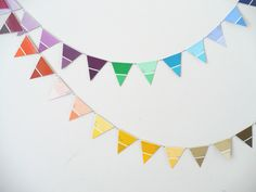 This great idea using paint chip cards would make a colorful addition {and simple!} to my craft fair booth this spring.