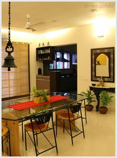 Just off the living room is the formal dining. custom made natural woven roman shades that have been given an ethnic feel by using borders from sarees
