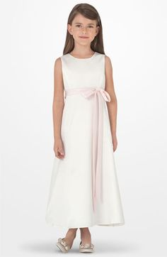 A not-too-frilly First Communion dress for my sweetie!  She liked it, she liked it!!!  You can choose the color of your bow - we are going with lavender.  Nordstrom.com...