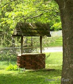 wishing well made from stacked bricks