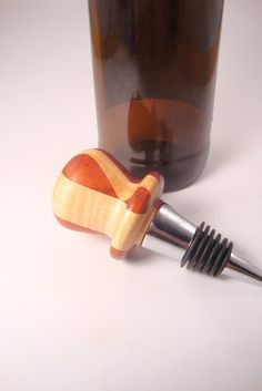 Wooden wine bottle stopper EXTREMELY UNIQUE. More info here: https://www.etsy.com/listing/103927884/wooden-wine-bottle-stopper-extremely