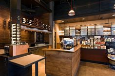 Abundance of warm wood tones and dark accents evokes the heritage feel. Starbucks Coffee, Portland hotels and restaurants Café Starbucks, Starbucks Reserve, Portland Bars, Portland Hotels, Portland Coffee, Coffee Shop Design, Dark Interiors, Cafe Interior, Interior Design