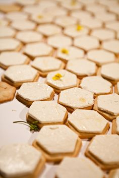 shortbread cookies, cream cheese, and broccoli blossoms drizzled with honey