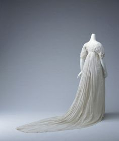 Dressc. 1805-England  Material:  White muslin one-piece dress with long train; white-work with small motif.