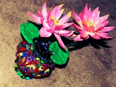 Creative DIY crafts: Coconut shell flower vase decorated with news pape...