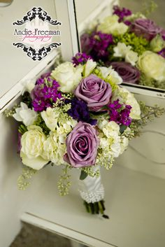 Purple and white fall bridal bouquet with sterling roses and hydrangeas on antique white vanity.  Classic Fall Wedding.  Photography:  Andie Freeman Photography www.TheAthensNewbornPhotographer.com  Coordinating:  Wild Flower Event Services Venue:  The Thompson  House and Gardens, Bogart, GA Floral:  Flowers by On