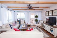 After, Living Room  Tour the Beach House Renovation From HGTV's Beach Flip | Beach Flip | HGTV