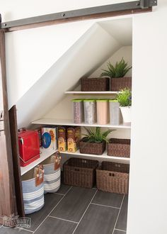 Many of our townhome models have a nook under the stairs, and this DIY uses the space well. Under Stairs Cupboard Storage, Under Stairs Pantry, Shelves Under Stairs, Stairway Storage, Space Under Stairs, Stair Shelves, Stairs In Kitchen, Hallway Storage, Attic Storage