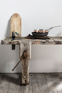 rustic wood table + wooden floors + wood cutting board .                        We have a leg vise like this in our work shop .