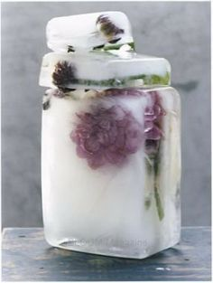 freeze flowers in ice for centerpieces? cool idea!