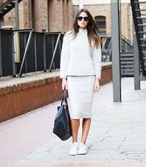 All white sneakers and skirt