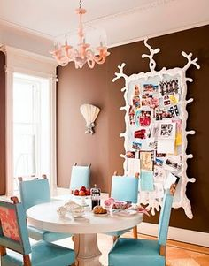 Beachy dining room. I love the aqua chairs and white pedestal table.