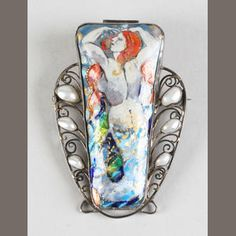 A George Hunt mermaid brooch Signed George Hunt, 1933, to the counter enamel,