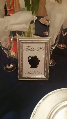 Beauty and the Beast theme table numbers. To cut cost, we bought plastic frames from the dollar tree and used metallic spray paint, printed the images on regular cardstock from michaels and done #beautyandthebeast #disneywedding #mrspotts