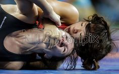 Latvia's Anastasija Grigorjeva, left, and Japan's Risako Kawai compete during the women's wrestling freestyle 63-kg competition at the 2016 Summer Olympics in Rio de Janeiro, Brazil, Thursday, Aug. 18, 2016. (AP Photo/Charlie Riedel)