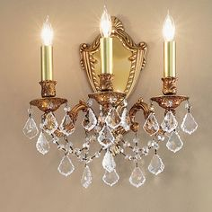 Classic Lighting Chateau Imperial 3 Light Wall Sconce Finish: Aged Bronze, Crystal Type: Swarovski Elements Golden Teak