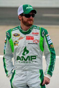 Dale Earnhardt Jr., driver of the #88 Amp Energy/National Guard Chevrolet, stands on pit road during qualifying for the NASCAR Sprint Cup Series Goody's Fast Relief 500 at Martinsville Speedway on March 31, 2012 in Martinsville, Virginia.
