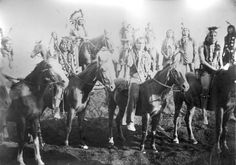 Native American Sioux men pose on horseback while touring with Buffalo Bill's Wild West Show in Europe, possibly in Paris. Additional men stand on the hill in the right background. Sioux Chief Rocky Bear is on horseback in the left background wearing a feather headdress and holding a spear. Several of the other men wear single or small custers of feathers on the backs of their heads. Date [1889?] Native American History, Native American Indians, Sioux Nation, Wild West Show, Feather Headdress, Male Poses, Buffalo Bills, First Nations, Art History