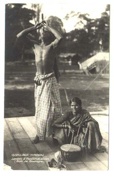 Indian sword swallower at an Inochine village in Jardin d'Agronomie Tropicale's human zoo c. 1907.