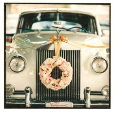 Rolls Royce with a wreath of roses on the nose! Great wedding transportation.