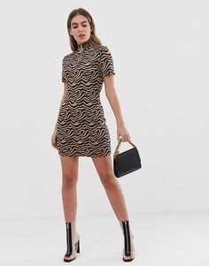a10dd461163 PrettyLittleThing zip front bodycon dress in tiger print