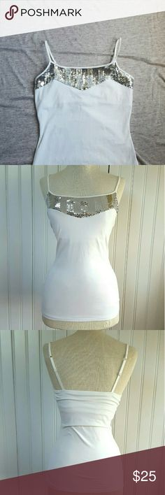 4th JULY SALE! Silver Sequin Shelf Bra Cami Tank ☆ BUY ONE GET ONE 50% OFF !☆  Super cute silver sequin cami by Express ! Shelf bra for extra support and adjustable straps. Perfect to wear under a blazer for work, or alone now that it's warm out ! Never worn, like-new condition. Express Tops Camisoles