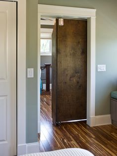 This sliding bookcase opens a secret entrance to the master bedroom.
