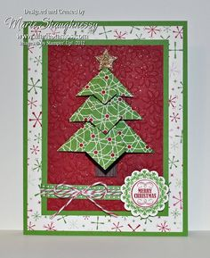 Tea Bag Fold Christmas Tree Card from MarieStamps.com shows another version of this origami fold. Features Stampin' Up!'s Be of Good Cheer DSP and the Petals-a-Plenty Embossing Folder.