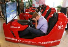 Prince Harry has a go on a Formula 1 driving simulator at the Ayrton Senna Institue on June 26, 2014 in Sao Paulo Brazil.