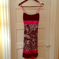 Spaghetti strap dress Back and white knit dress. Empire waist with hot pink satin trim and ribbon in back. Size medium, but dits a small. Dresses