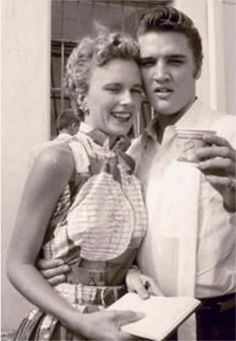 Elvis in Tampa bay august 5th 1956,here eating cup a soup and chating with fans outside of his hotel.