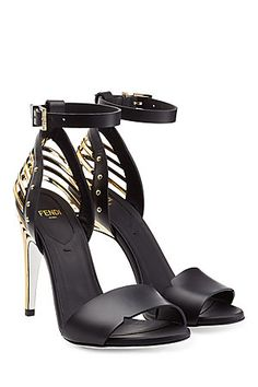 The graphic, cage-inspired heel of these Fendi sandals $950 FP