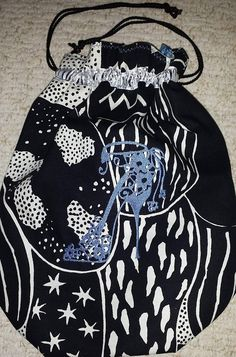 Handmade cotton canvas shoe bag with embroidered shoe design Colourful Blue cotton lining and ribbon adornment Draw string closure Approximately x Fashion Handbags, Cotton Canvas, Designer Shoes, Drawstring Backpack, Birthday Gifts, Christmas Gifts, Classy, Black And White, Shoe Bag