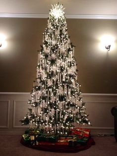 Green tree with only crystal ornaments....green tree with red bows and gold ball ornaments with gold ting ting....white tree with retro ornaments and lights