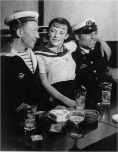 Conchita avec les marins, Place d'Italie, Paris, c.1933 by Brassaï