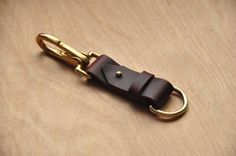 * Simple, Classy, Quality * - Customizable - Can be personalized - Maroon Horween Leather Each key fob is handmade with love and precision. You can choose the colour or add a personalized name, word or saying. If youd like a different shape, just let us know, wed be happy to make any custom patterns you have in mind. Each key chain includes a brass metal D ring that is 30mm in diameter and a quick release, brass clip. These are very strong, sturdy and thick key rings. Theyre strong enough…